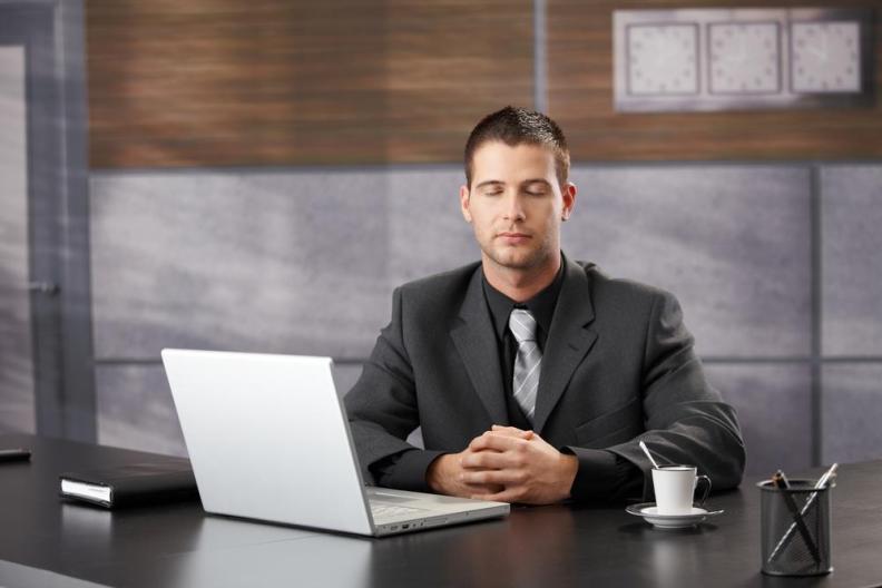 manMeditationOfficeSuit
